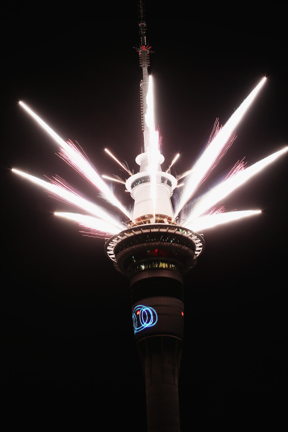 AUCKLAND, NEW ZEALAND - JANUARY 01: A fireworks display is launched from the Auckland Sky Tower during New Year's Eve celebrations on January 1, 2016 in Auckland, New Zealand. (Photo by Hannah Peters/Getty Images)