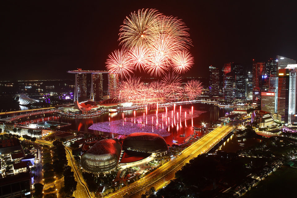 SINGAPORE - JANUARY 01: Fireworks explode over the Esplanade and Marina Bay Sands as Singapore celebrates the New Year at Marina Bay on January 1, 2016 in Singapore. (Photo by Suhaimi Abdullah/Getty Images)