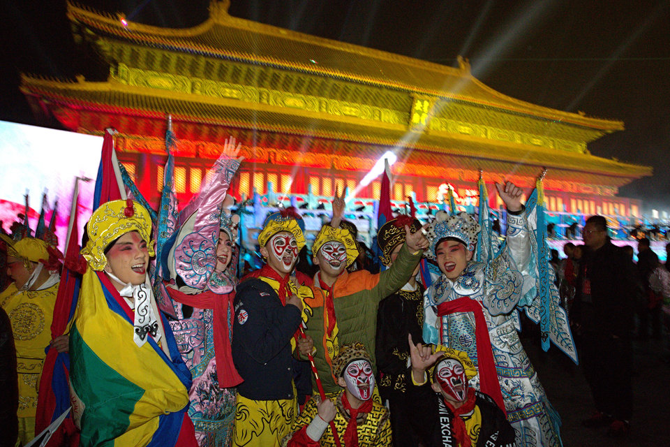 Performers pose for photos before the countdown to the New Year at an event in Beijing, China, Thursday, Dec. 31, 2015. (AP Photo/Ng Han Guan)