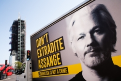 A billboard van calling for an end to extradition proceedings against WikiLeaks founder Julian Assange